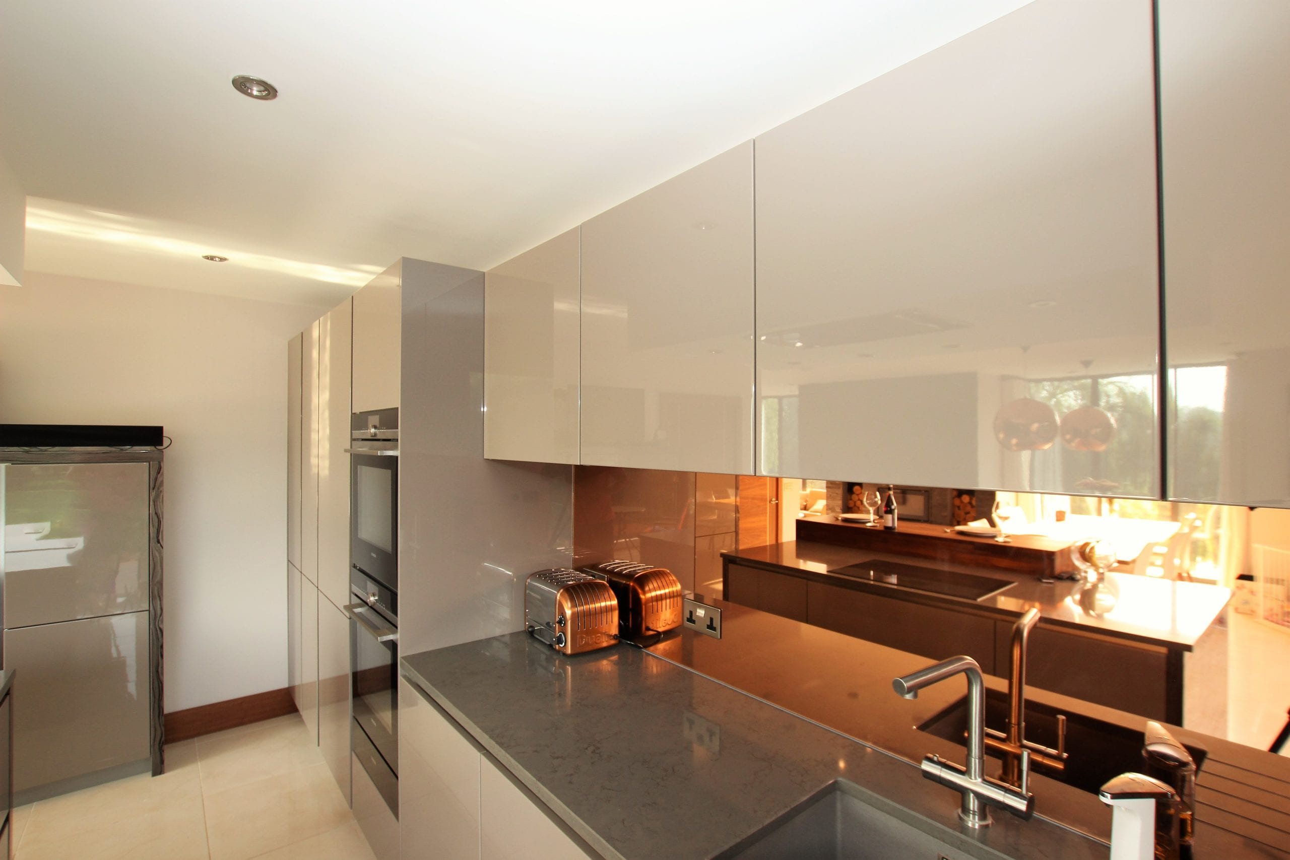 16. Bronze mirror splashback scaled - John Willox Kitchen Design, Ellon