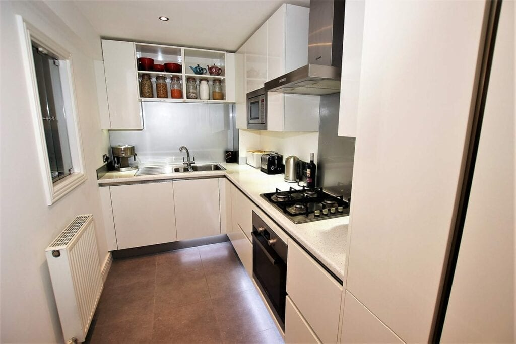 Small White Kitchen Layout | Daval Client Site, Wansford